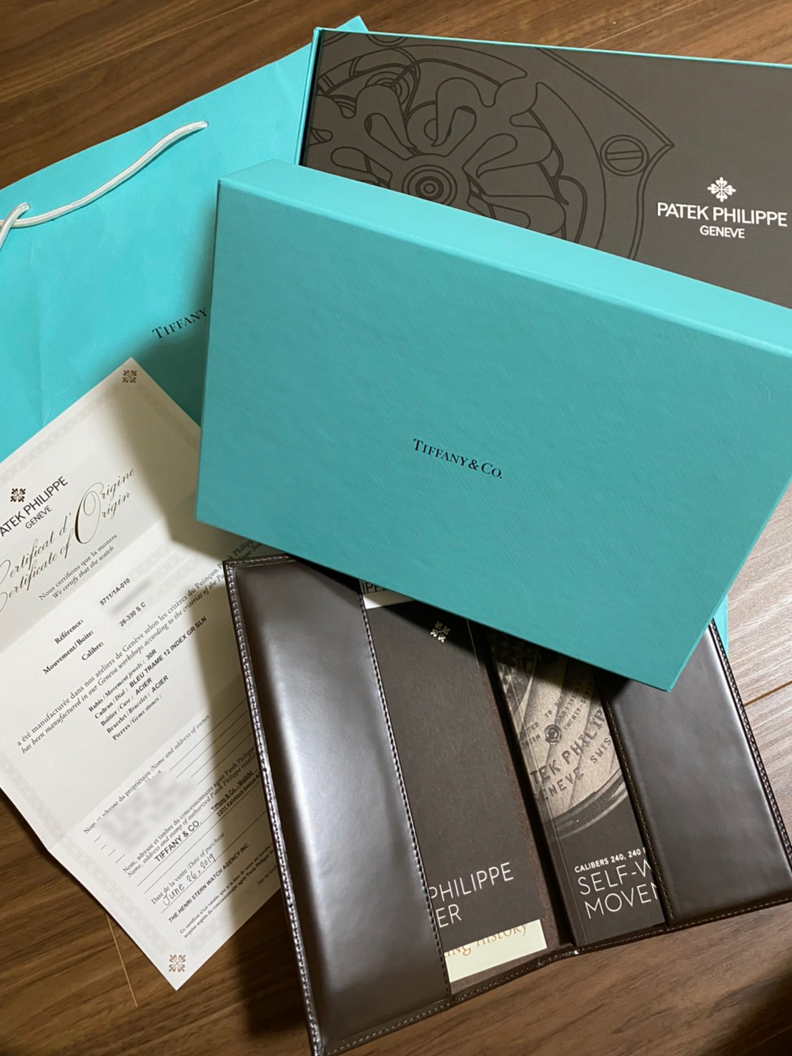 Patek Philippe Ref 5711 retailed by Tiffany and Co in New condition #status Sold